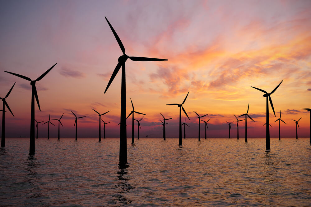 offshore wind turbine at sunset