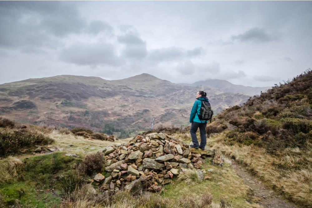 woman hiking through Wales