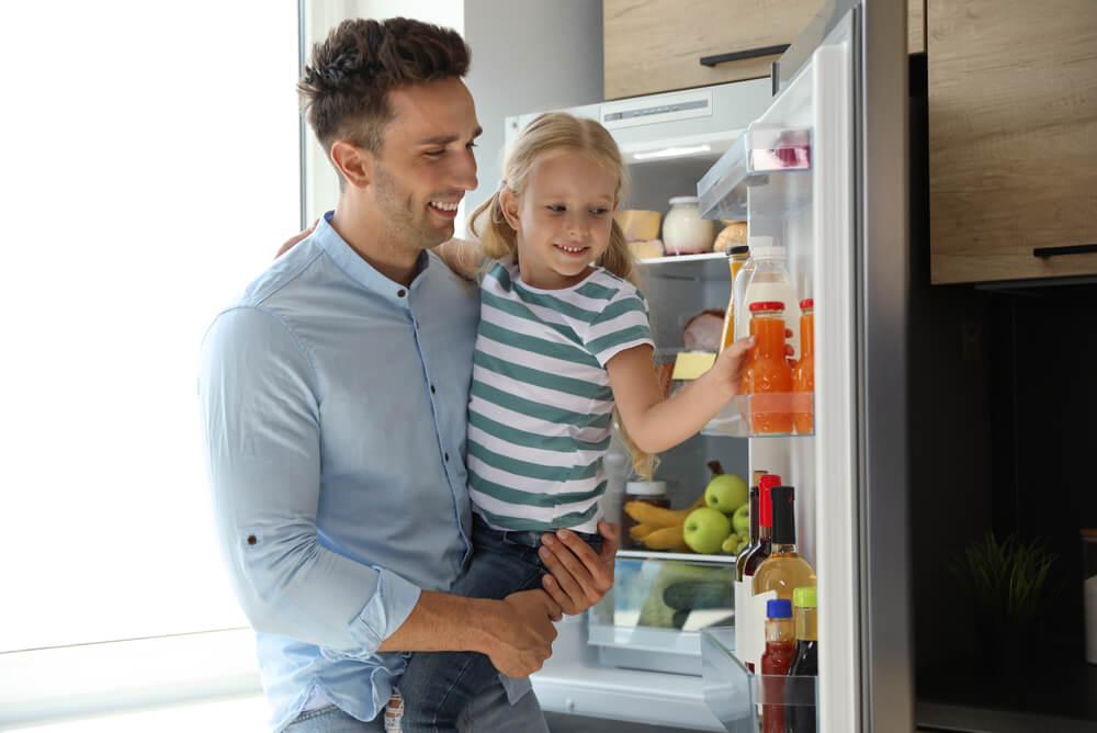 family enjoing their energy efficient fridge