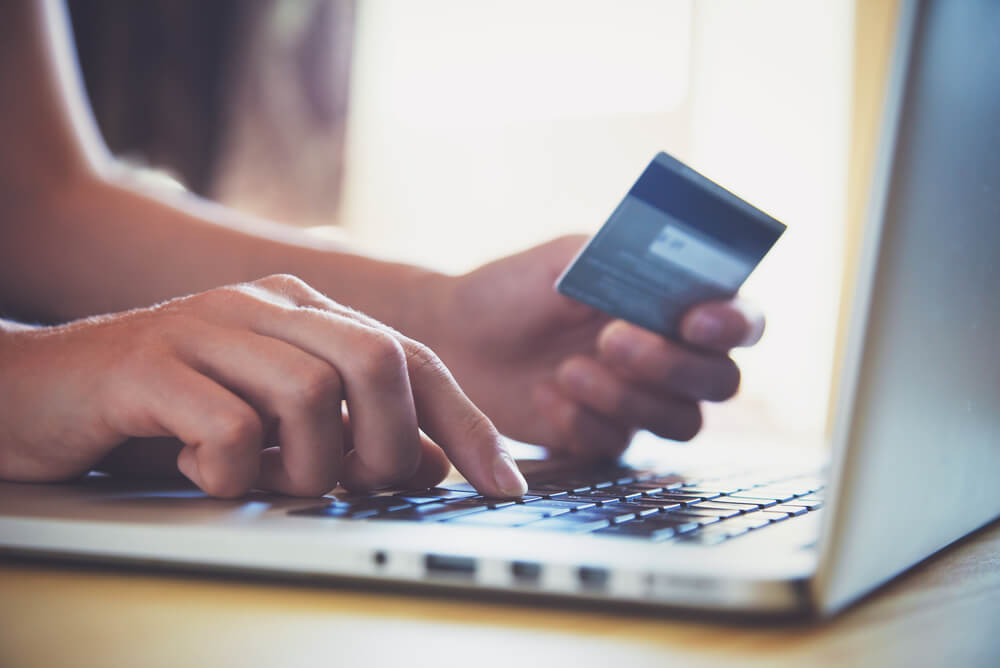 man completing an instant approval credit card application