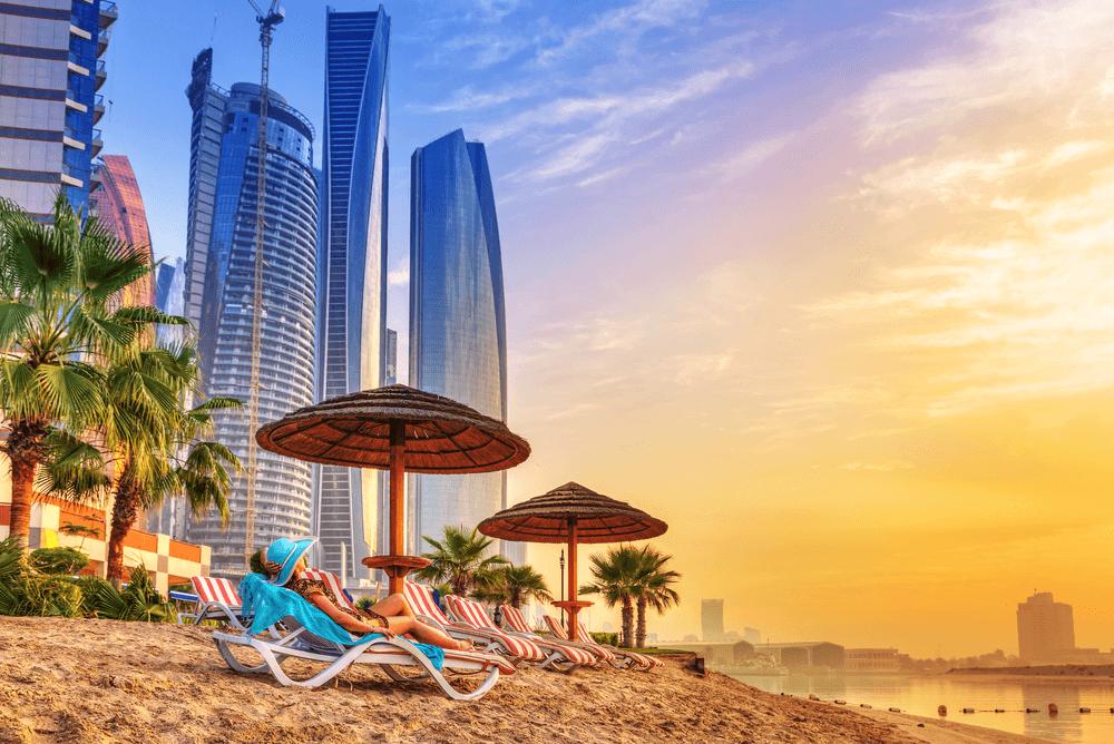 a lady sunbathing at a tourist beach in Dubai