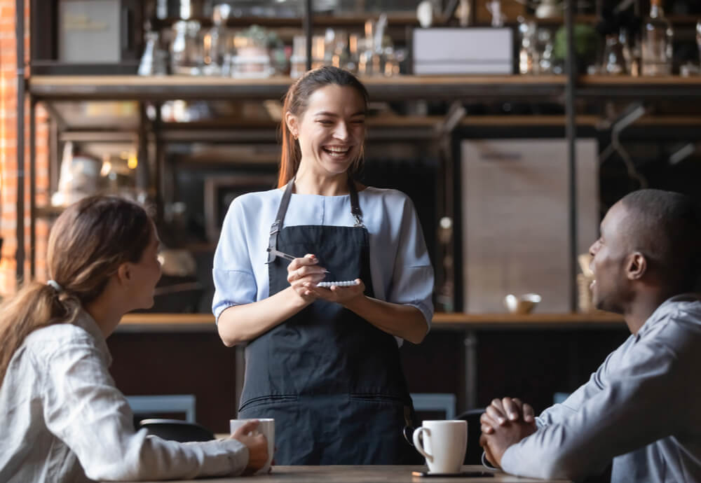 woman with working holiday visa travel insurance at cafe
