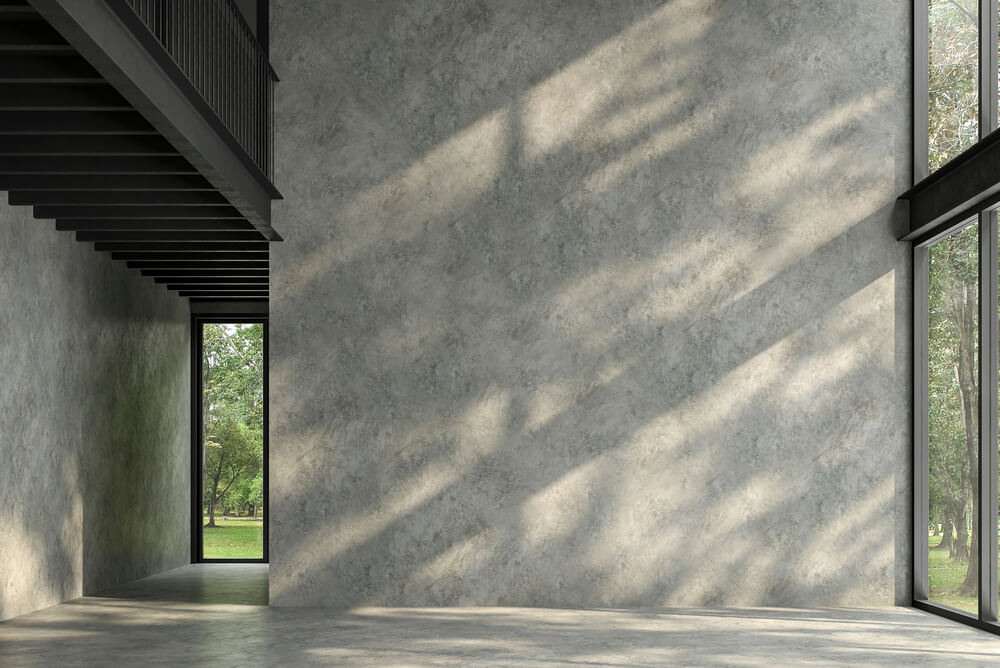 shadows falling on a concrete and steel house interior