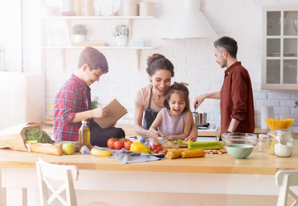 a family cooking dinner in the kitchen