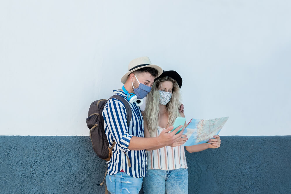 a young couple travelling looking at a map