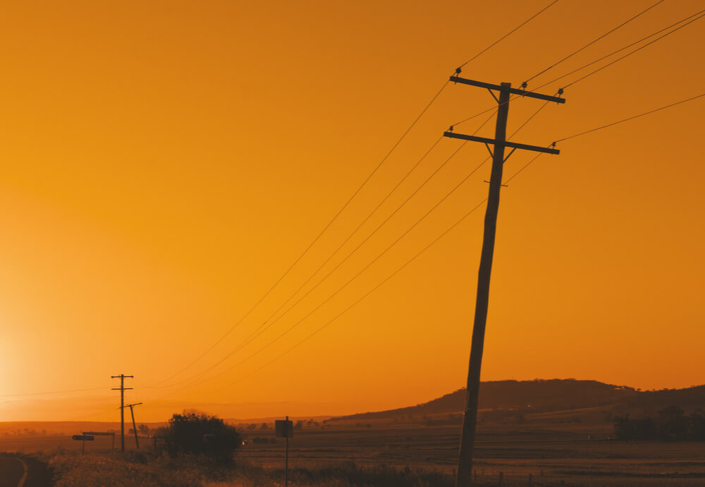 power poles in the Australian outback at sunset