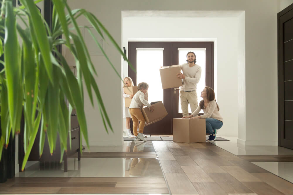 a young family moving into their new home after comparing home loans
