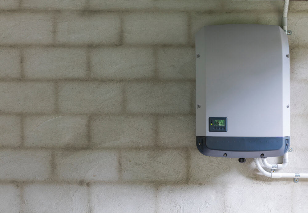 a home solar battery system on a brick wall