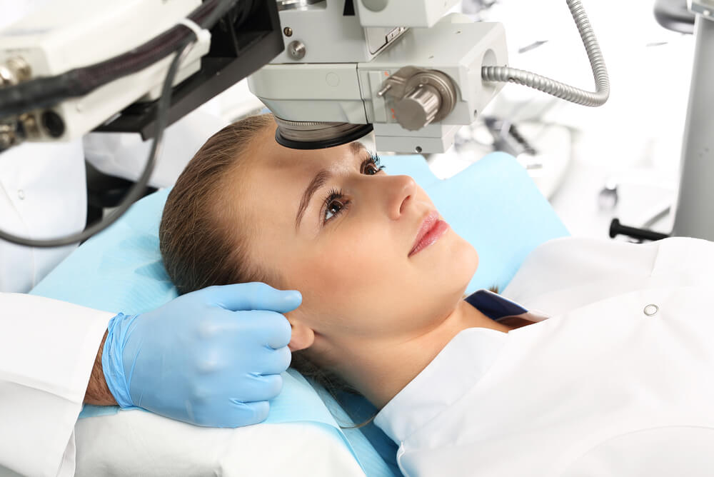 young woman getting laser eye surgery covered through optical health insurance benefits