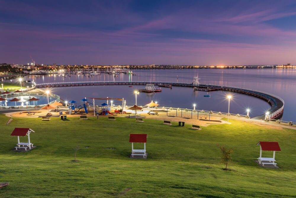 Dusk view of the city of Geelong lit up with electricity representing cheapest electricity Geelong