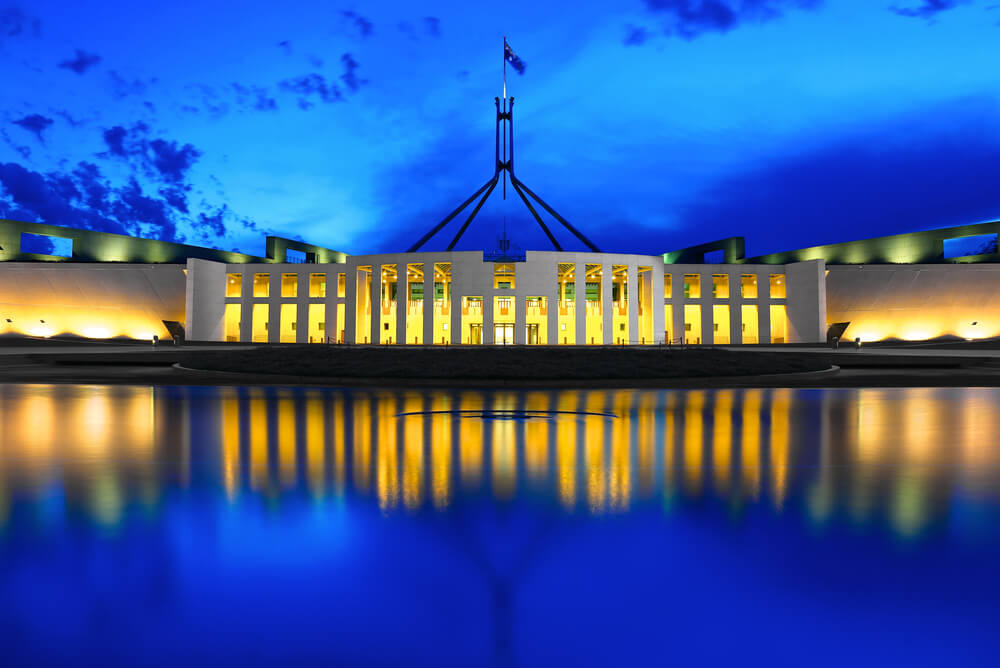 parliament house at twilight representing cheapest electricity canberra act