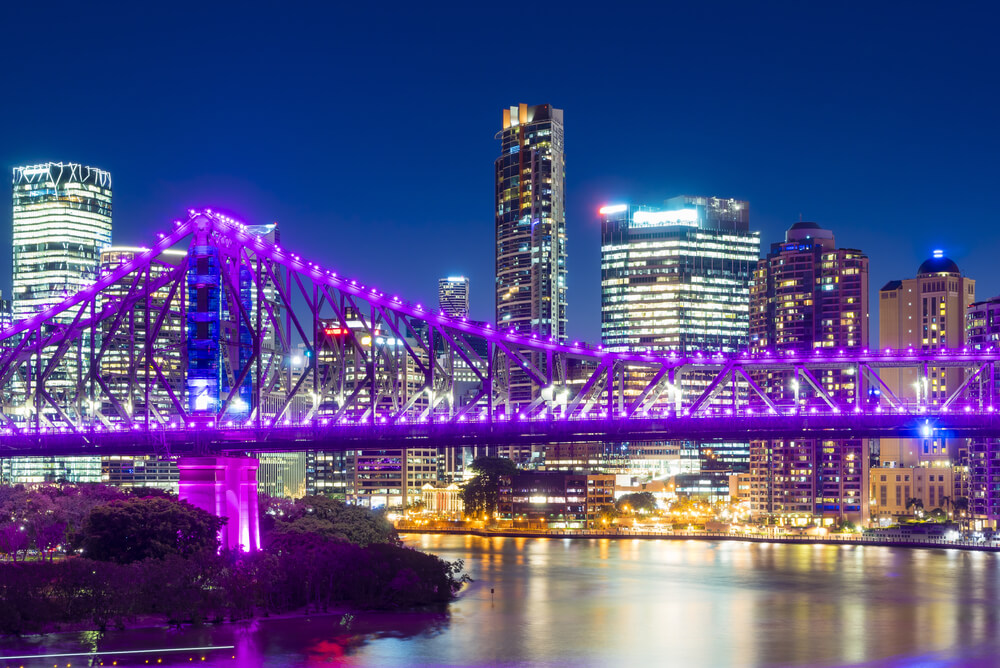 story bridge and city at night representing cheapest electricity brisbane