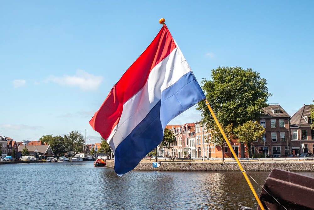The Netherlands flag next to Spaarne in Haarlem