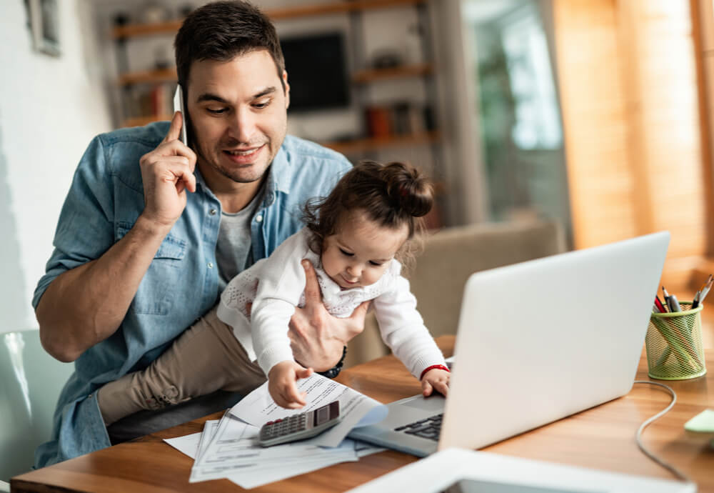 a dad on the phone updating his insurance policy with daughter
