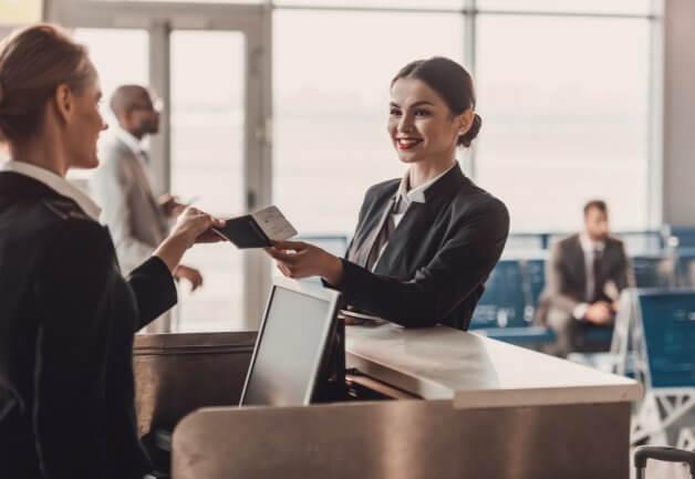 smiling woman handing over her passport