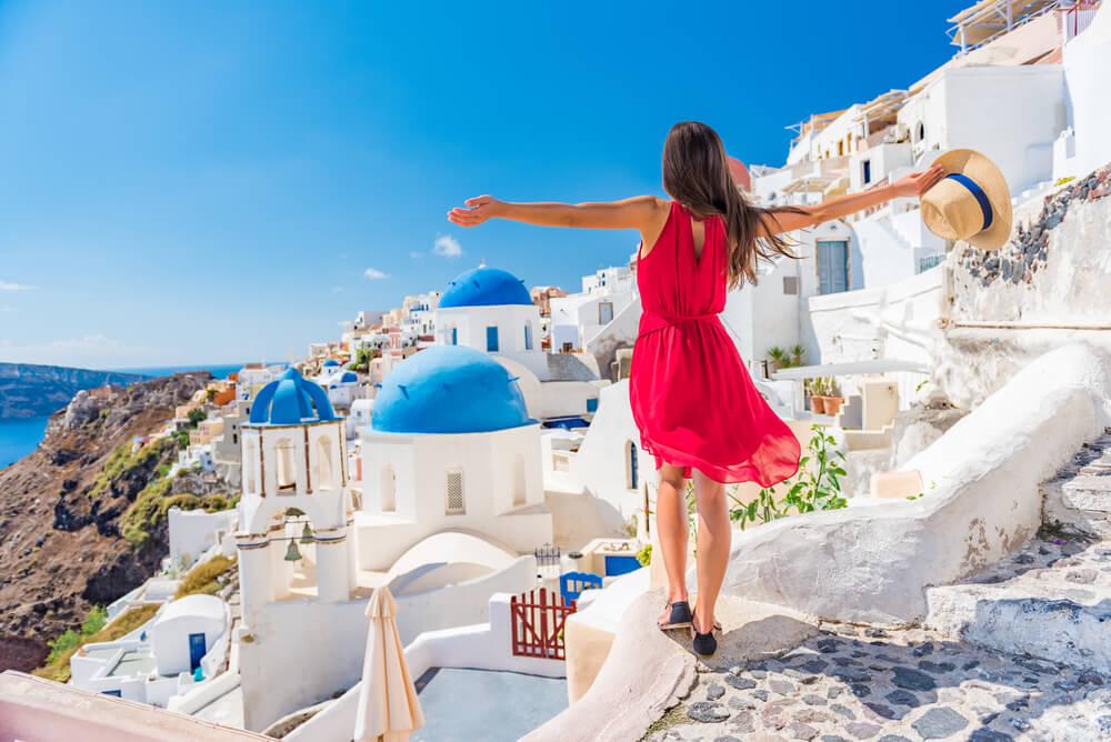 woman embracing the view in Santorini Greece