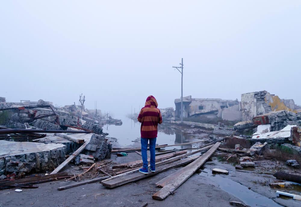 Boy watching flood devastation