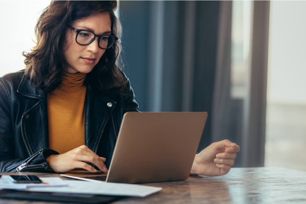 Woman in glasses calculating expenses