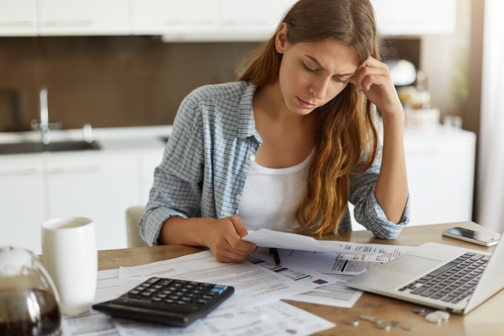 bill shock woman financially stressed